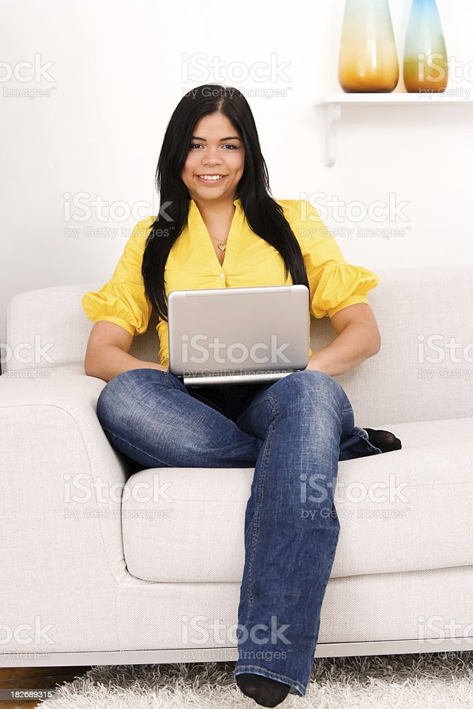 Casual Woman Working on a Notebook or Netbook Computer royalty-free stock photo