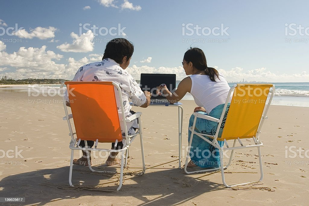 Casual Workers at the beach royalty-free stock photo