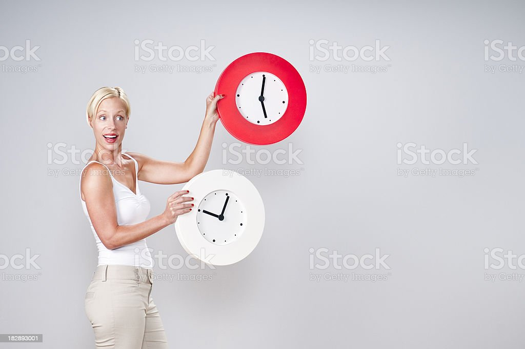 Casual Young Blonde Juggling Clocks royalty-free stock photo