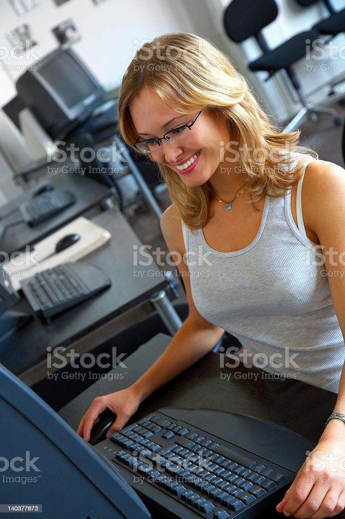 Casual young business woman working on computer royalty-free stock photo