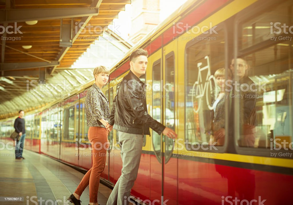 Casual young couple waiting the train royalty-free stock photo