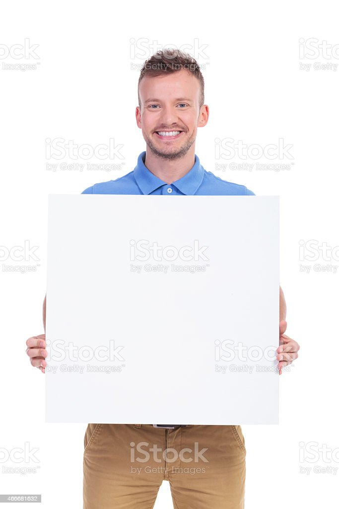 casual young man shows his blank board stock photo
