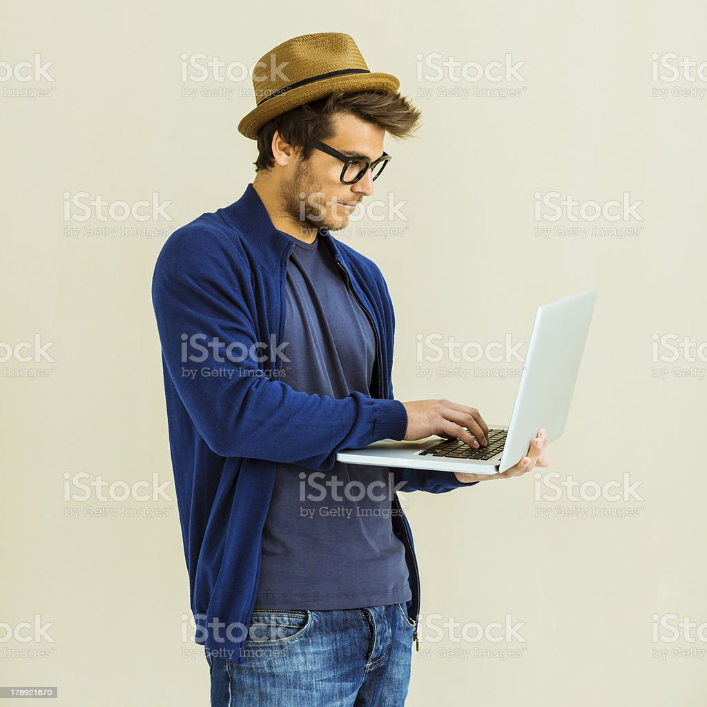 Casual young man using laptop royalty-free stock photo