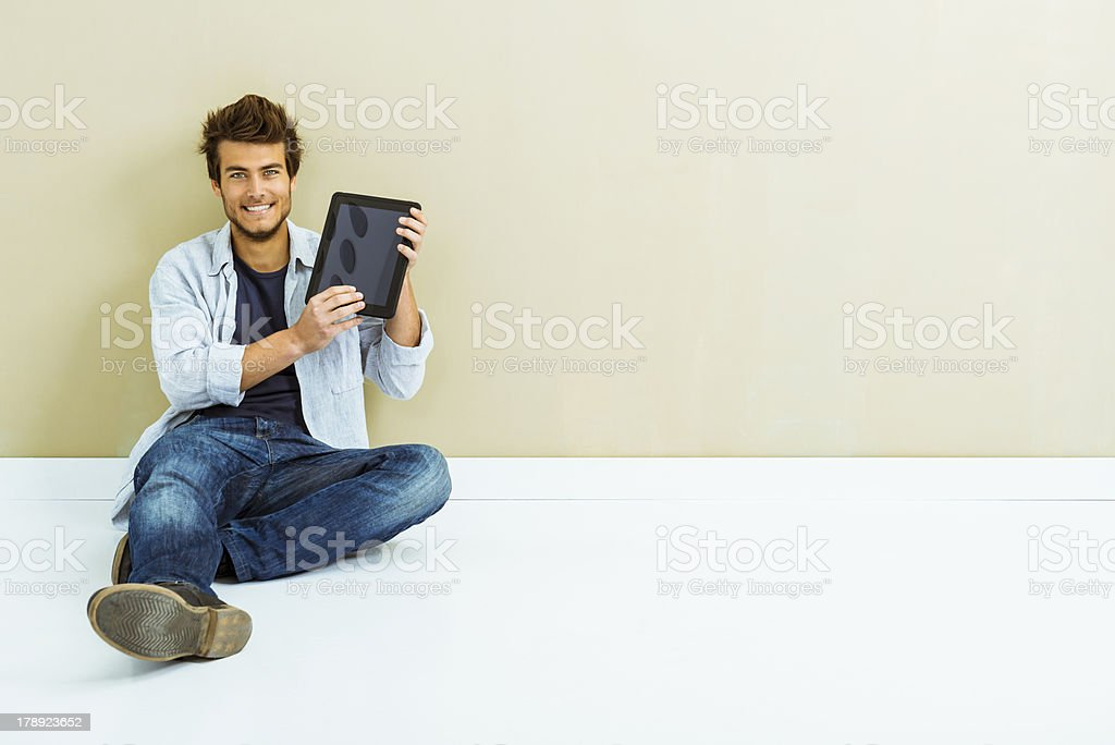 Casual young man using tablet royalty-free stock photo