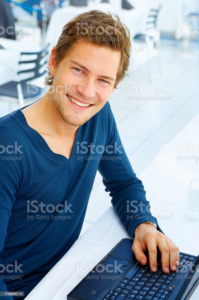 Casual Young man with his laptop royalty-free stock photo