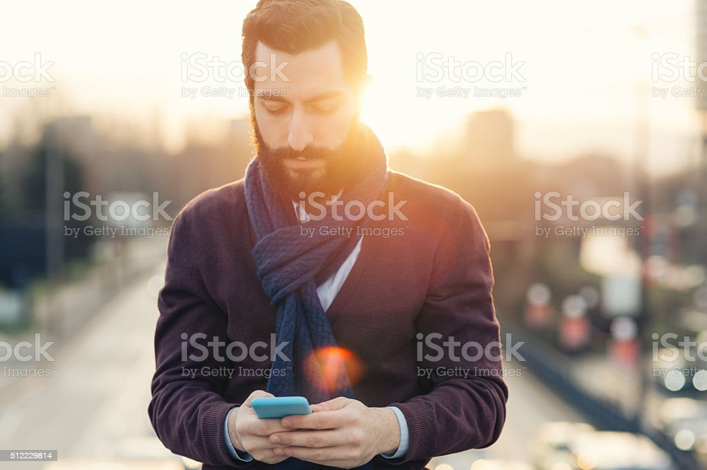 Casual young man with smartphone stock photo