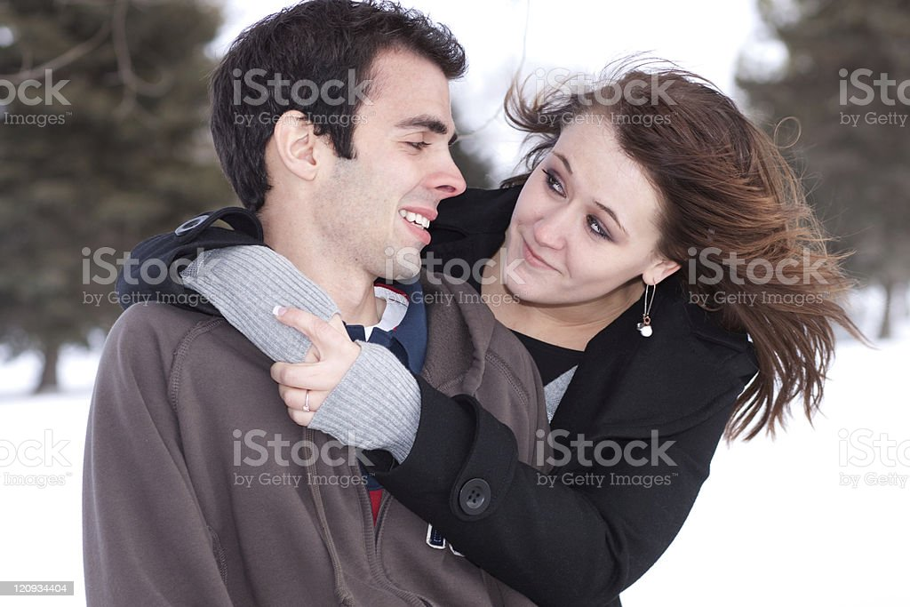 Casual Young Romantic Couple Embracing in Winter royalty-free stock photo