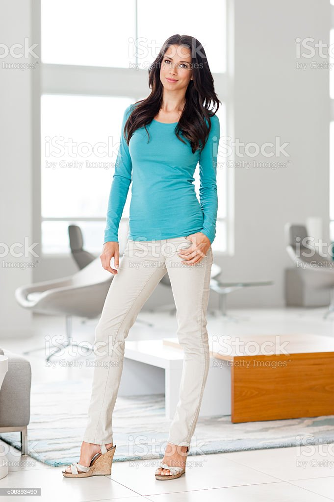 Casual Young Woman  in Showcase Home stock photo