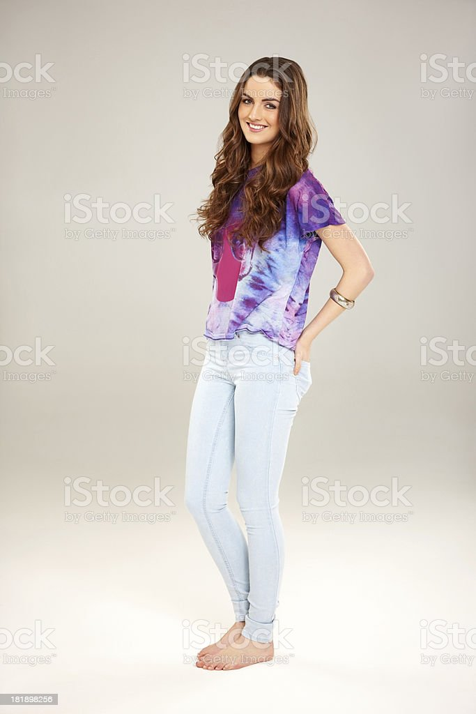 Casual young woman posing on grey royalty-free stock photo