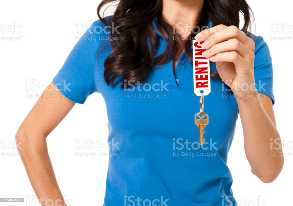 Casual Young Woman with House Keys Isolated on White Background stock photo