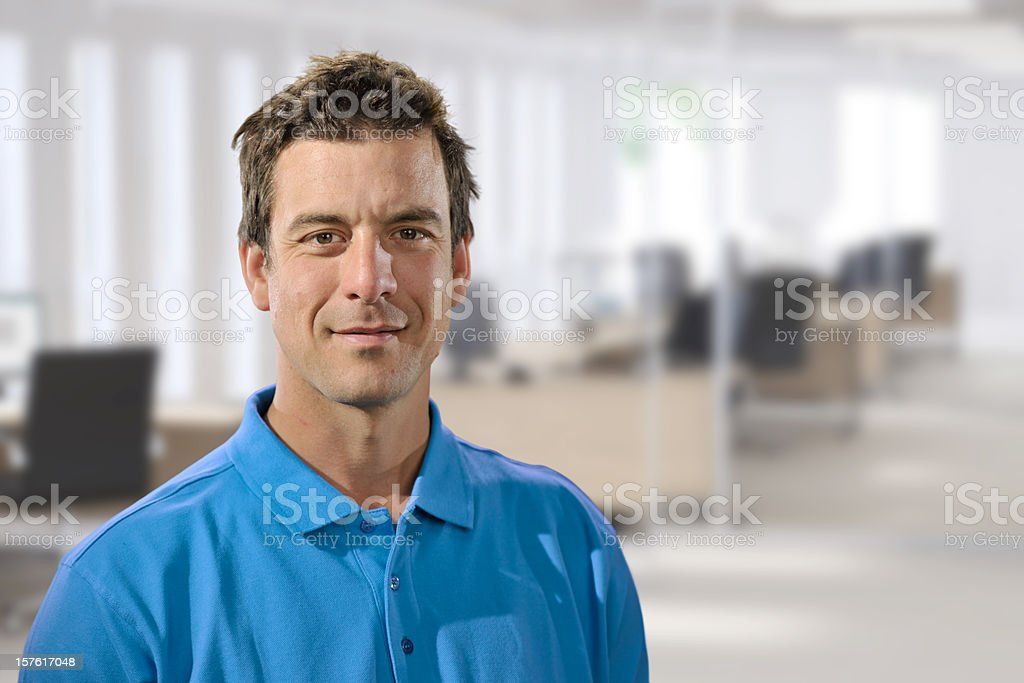 casually dressed man in office stock photo