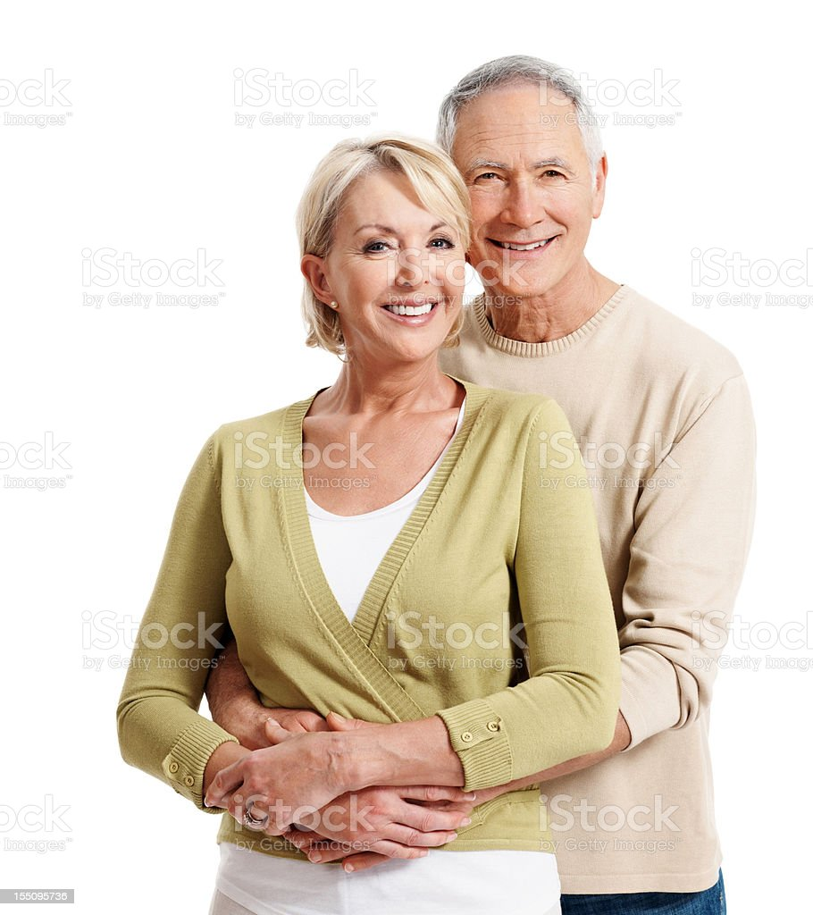 Casually dressed mature couple smiling royalty-free stock photo