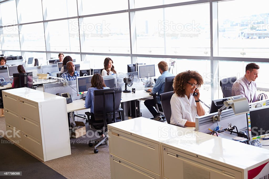 Casually dressed workers in a busy open plan office stock photo