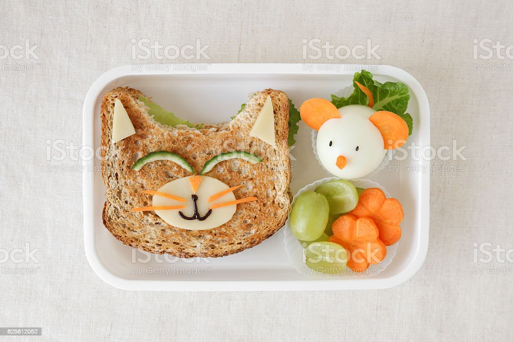Cat and mouse lunch box, fun food art for kids stock photo