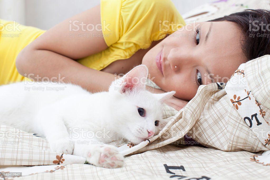 Cat and woman in to the bed royalty-free stock photo