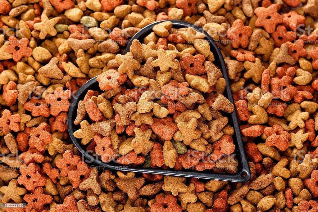 cat dry food filled in a heart, background royalty-free stock photo