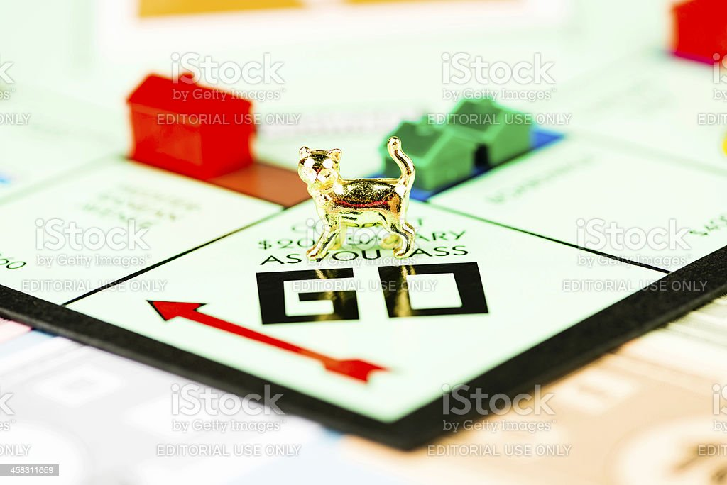 Cat Token on Monopoly Board royalty-free stock photo