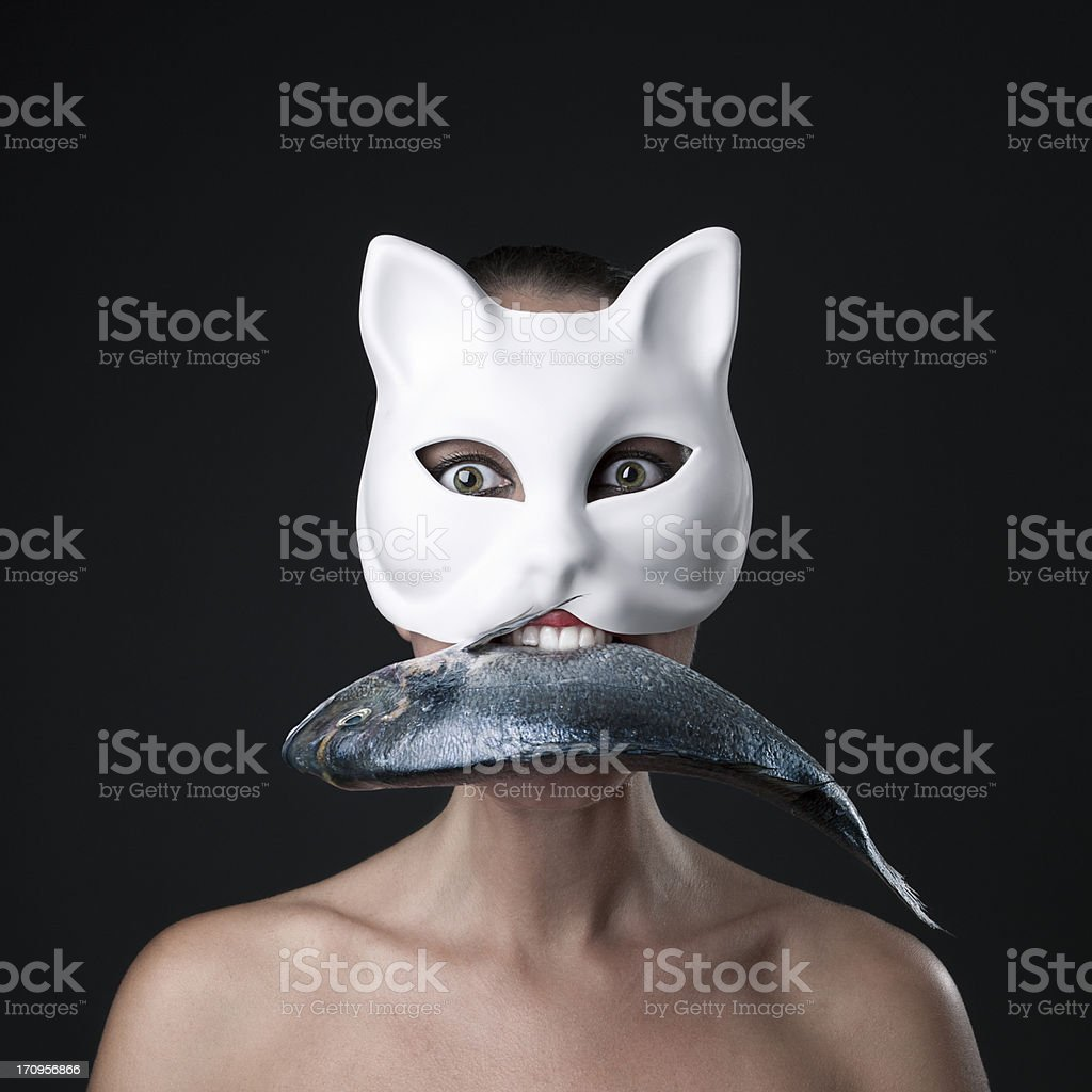 Cat women with a fish in his mouth royalty-free stock photo