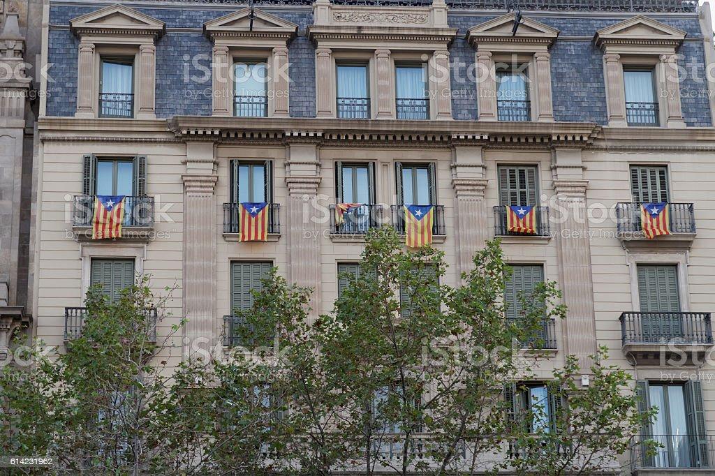 Catalan flag Estelada hanging from balconies in Barcelona, Spain. stock photo