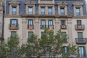 Catalan flag Estelada hanging from balconies in Barcelona, Spain.