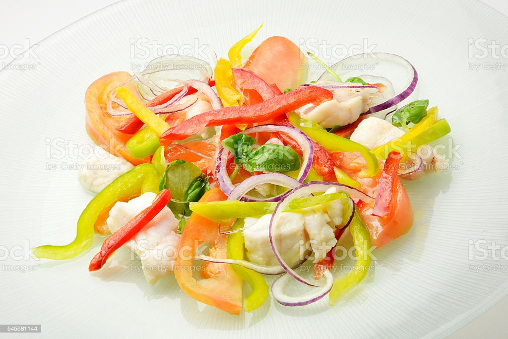 Catalan white fish - redfish and sliced raw vegetables stock photo