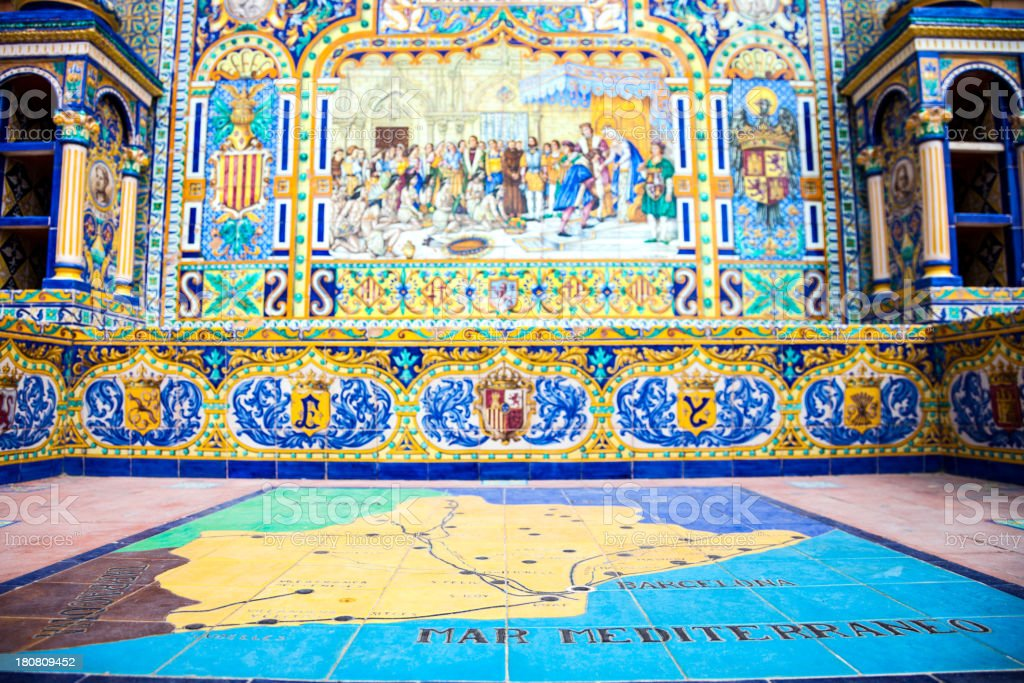Catalonia map, Typical spanish tiles in Plaza de Espana, Seville royalty-free stock photo