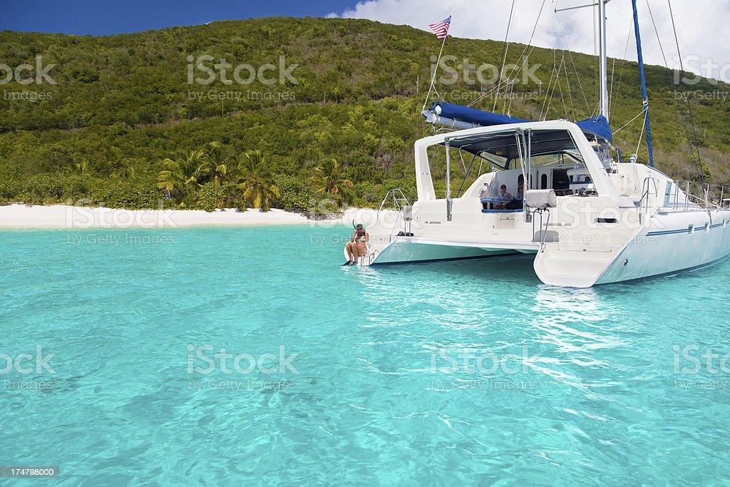 catamaran anchored at a tropical island in the Caribbean royalty-free stock photo