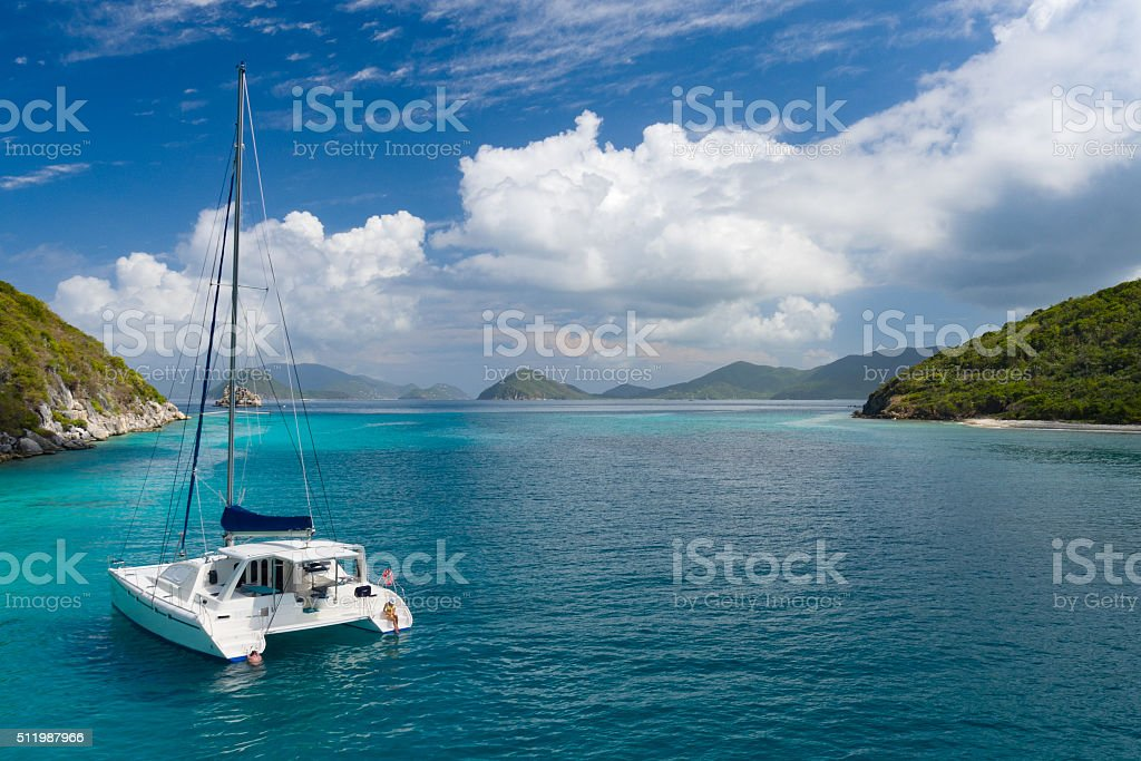 Catamaran anchored by Lovango Cay, US Virgin Islands stock photo