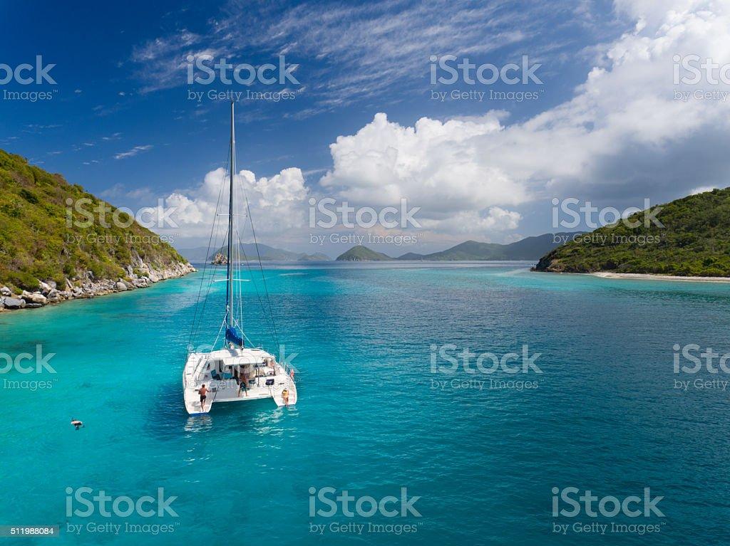 Catamaran anchored by Lovango Cay, US Virgin Islands stock photo