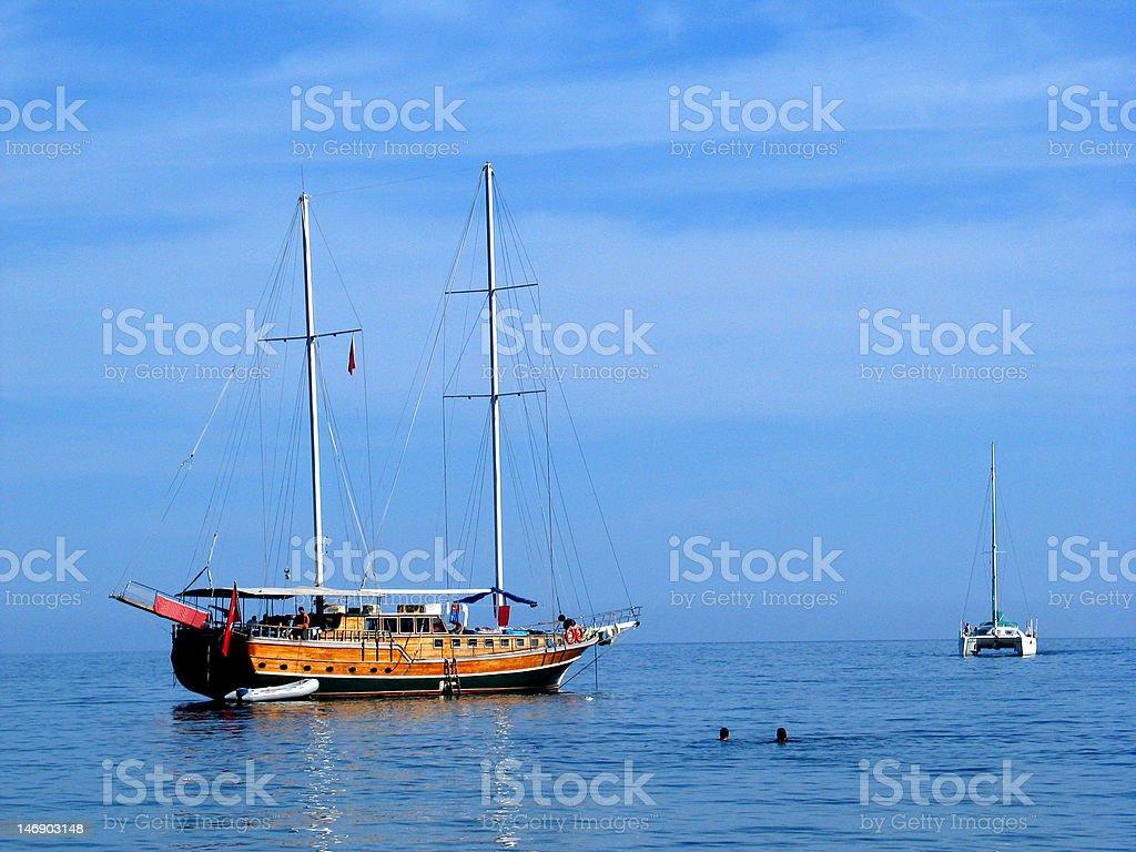 Catamaran and gulet stock photo