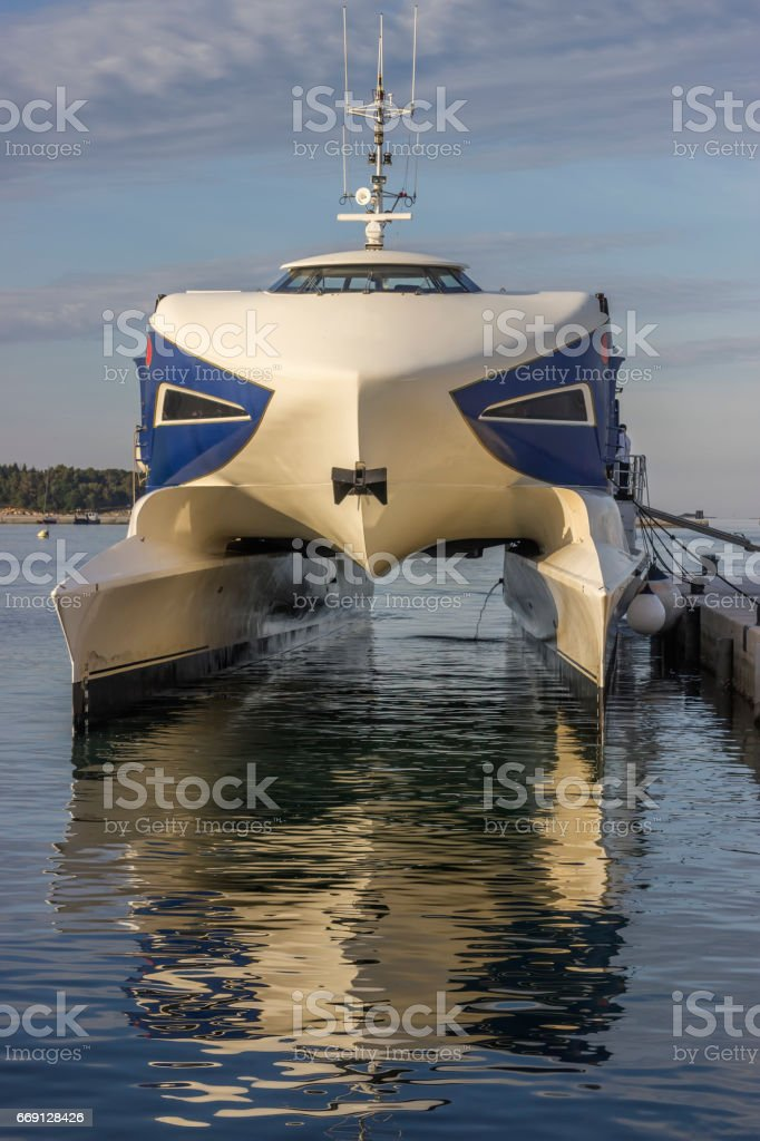 Catamaran ferry ship docked at port 2 stock photo