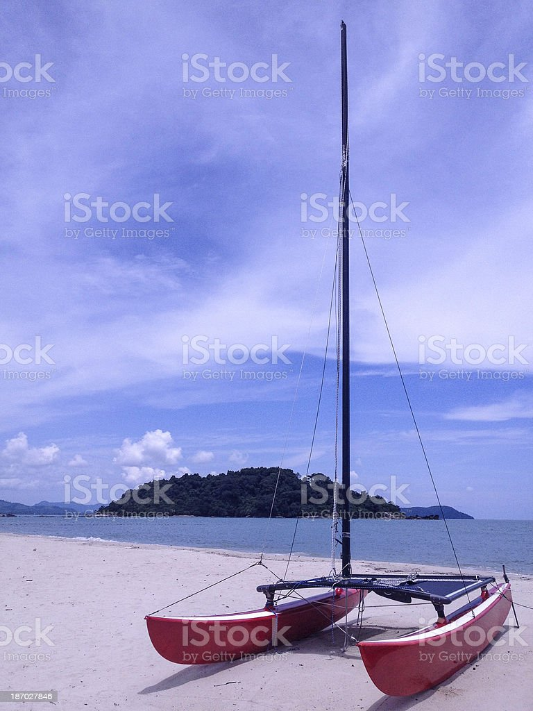 Catamaran grounded on the beach in Langkawi royalty-free stock photo