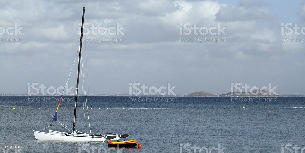 Catamaran in the sun stock photo