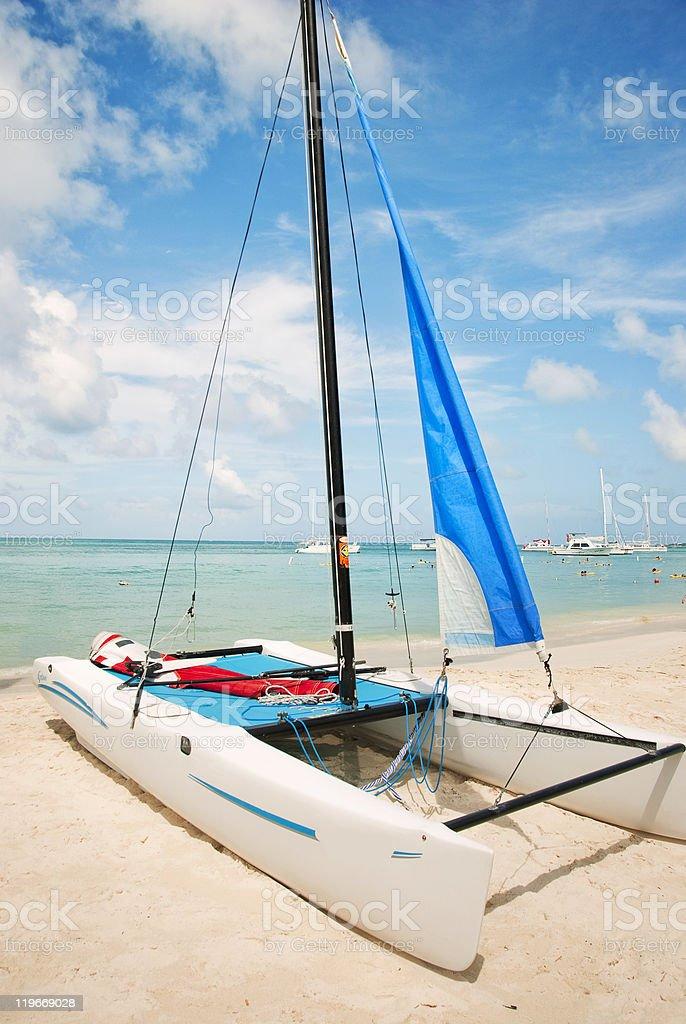 Catamaran on the Beach in Aruba stock photo