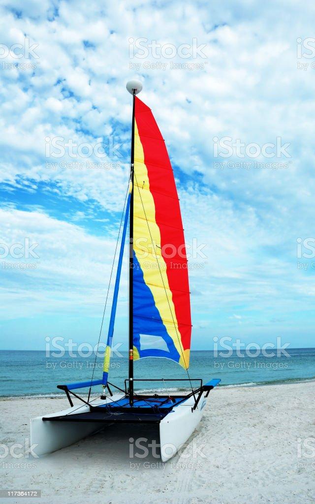 Catamaran sailboat on beach stock photo