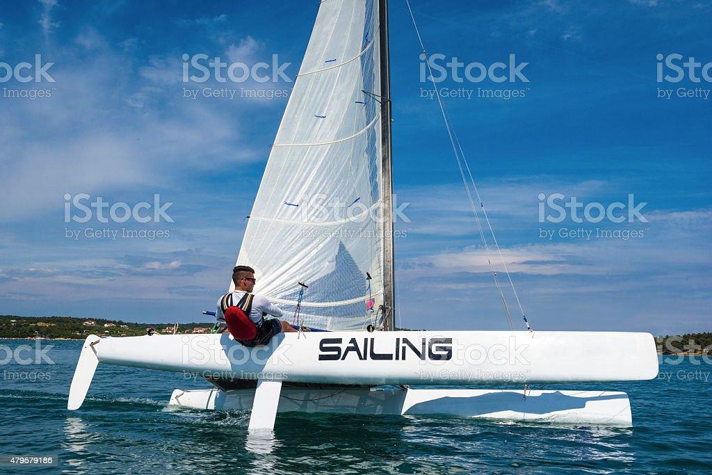 Catamaran sailing boat leaning stock photo