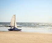 catamaran yacht standing on a deserted beach