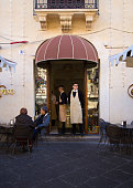 Catania, Sicily: Baristas in Doorway; Customers at Table