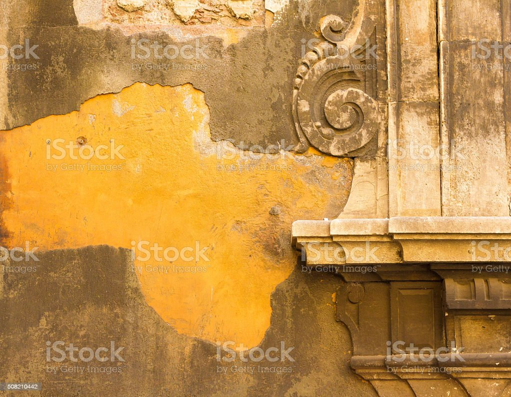 Catania, Sicily: Beautiful Baroque Detail on Old Yellow Wall stock photo