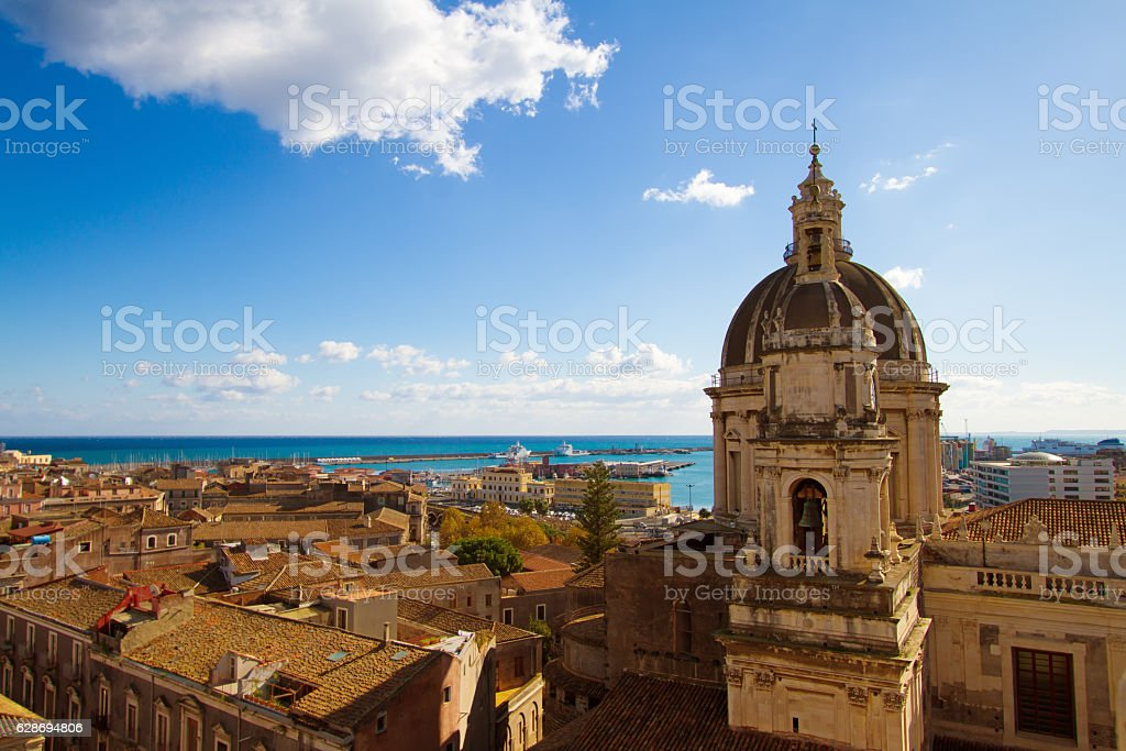 Catania, Sicily: Old Town Panorama with Cathedral Cupola and Sea stock photo
