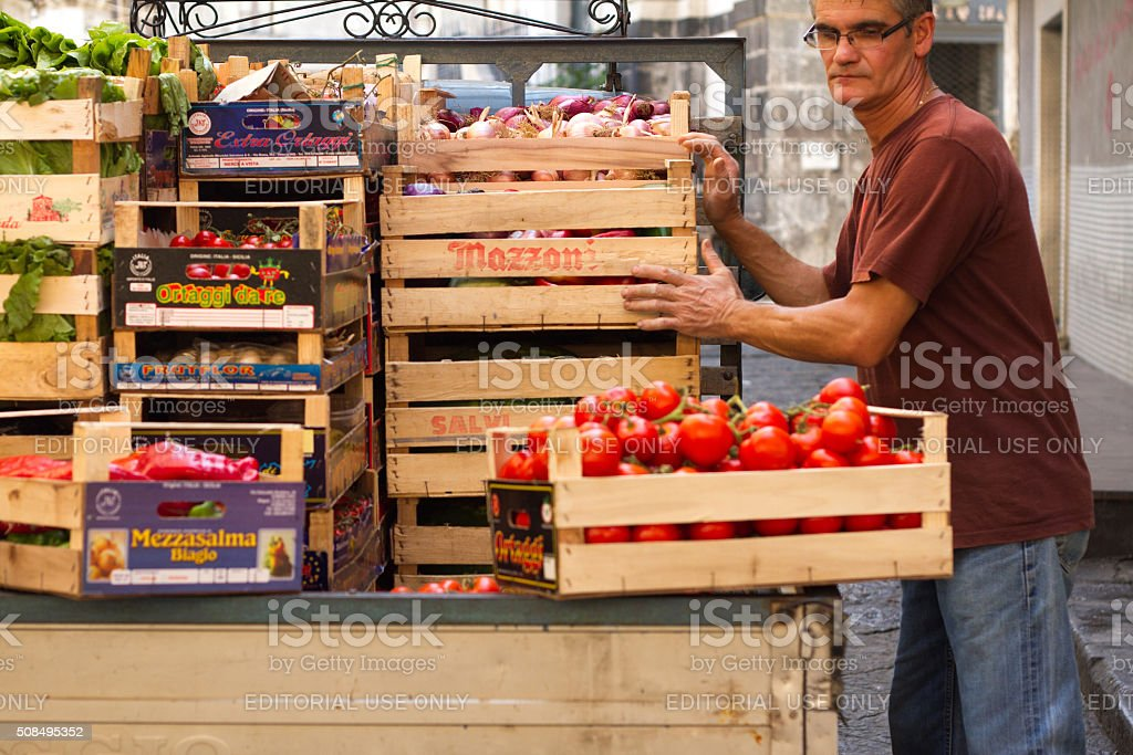 Catania, Sicily: Vendor Loading Crates of Vegetables into Pickup Truck stock photo