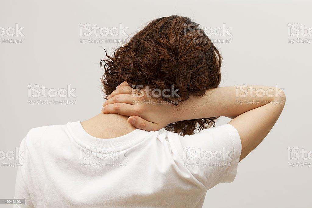 catch back of neck pain stock photo