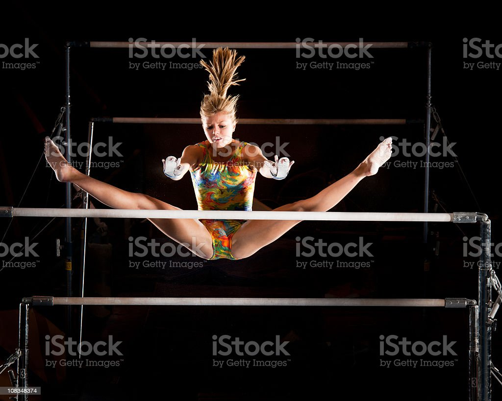 Catch it girl! Gymnast in flight stock photo