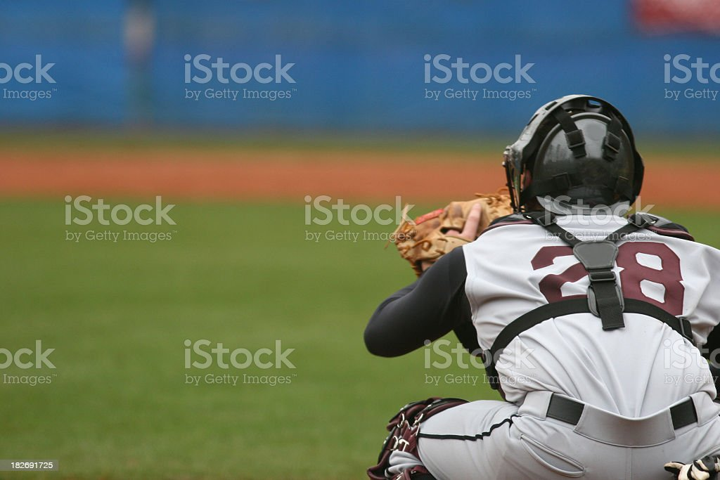 Catcher at a baseball game in position to catch royalty-free stock photo