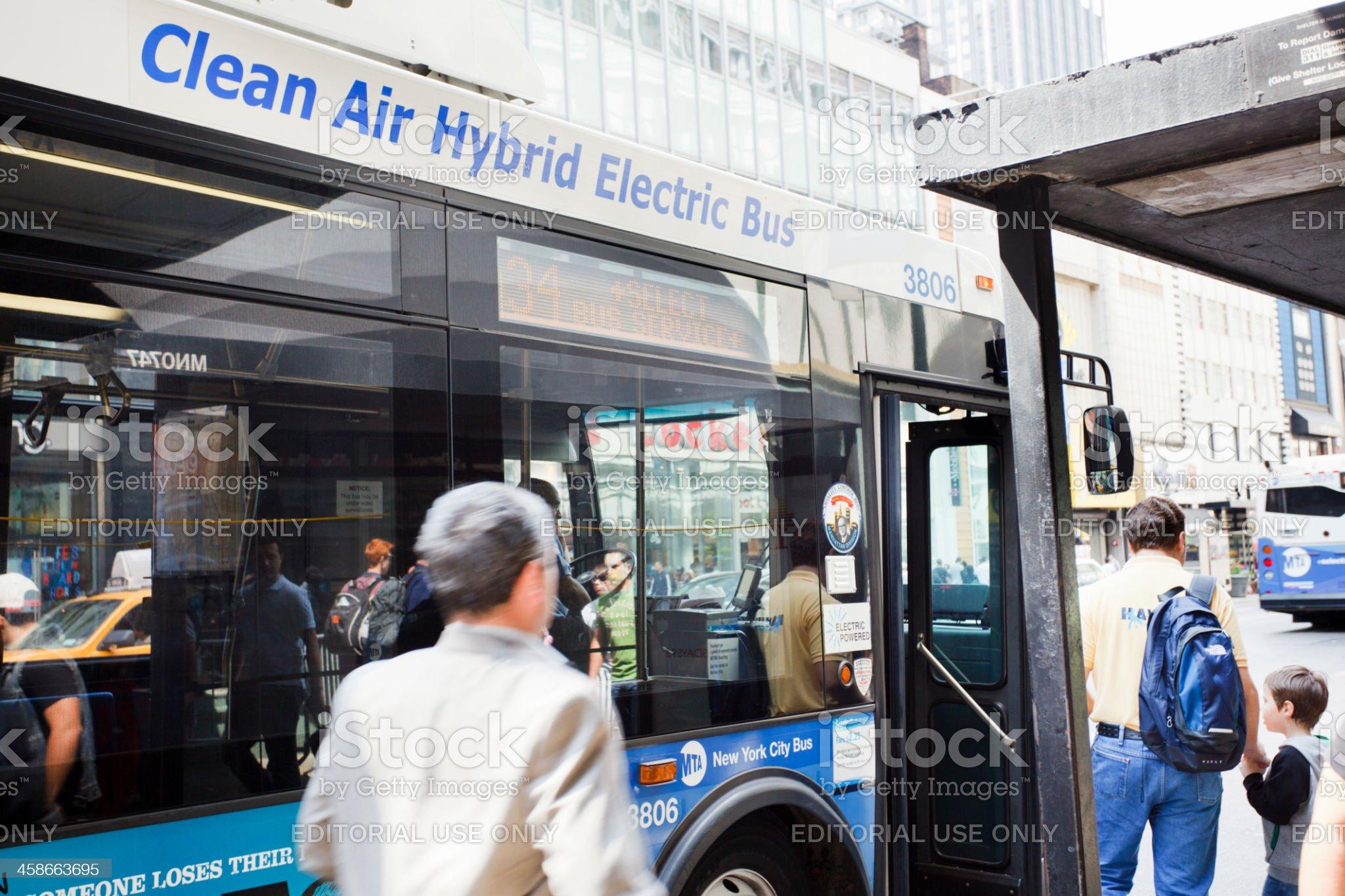 Catching a Hybrid Bus Manhattan royalty-free stock photo