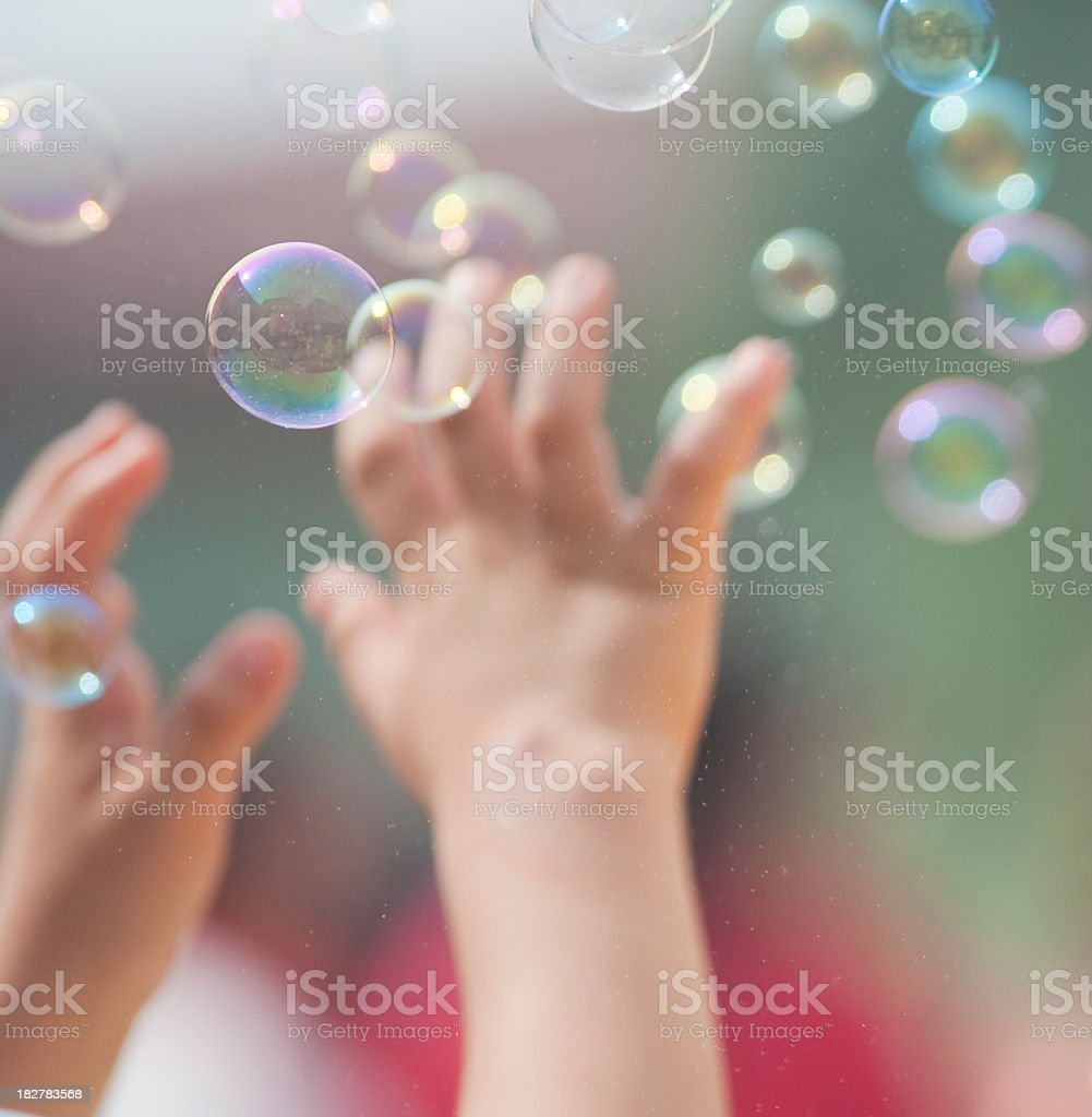 catching bubbles stock photo