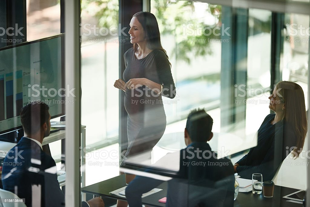 Catching everyone up before maternity leave stock photo