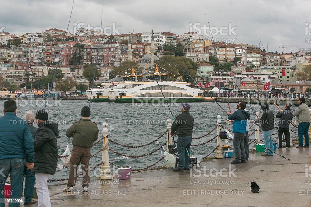 catching fish with angler at uskudar coast of istanbul turkey stock photo