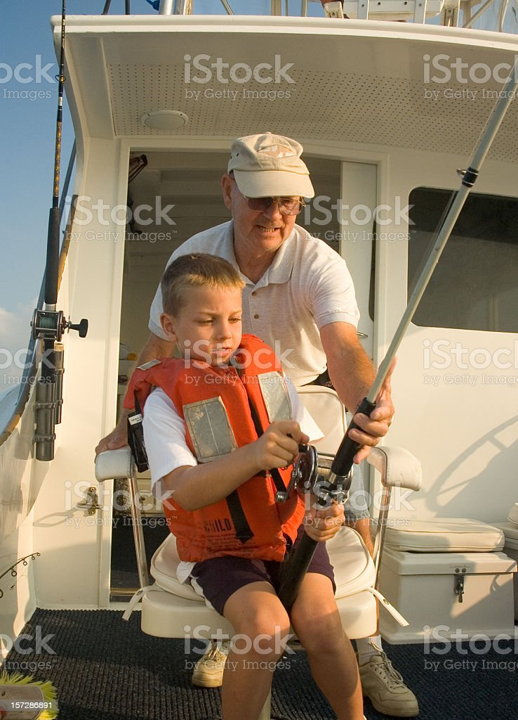 Catching Fish With Grandpa stock photo