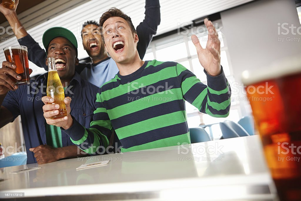 Catching the game at their local bar stock photo
